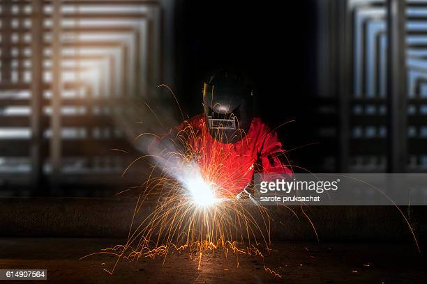 Industrial worker welding metal