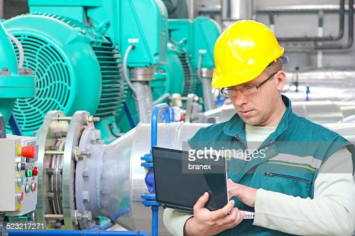 Industrial worker with notebook : Stock Photo
