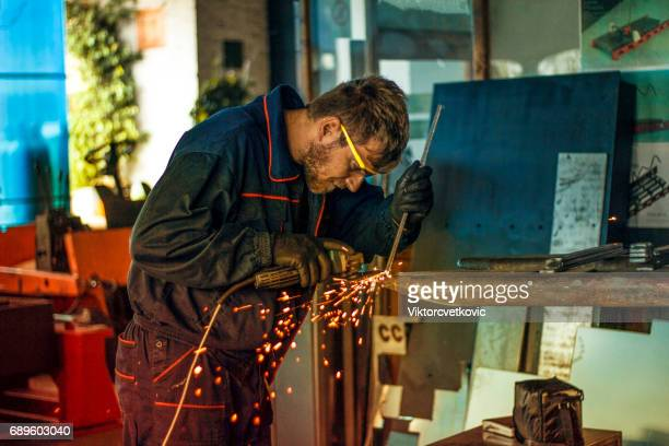 Industrial worker with work tool