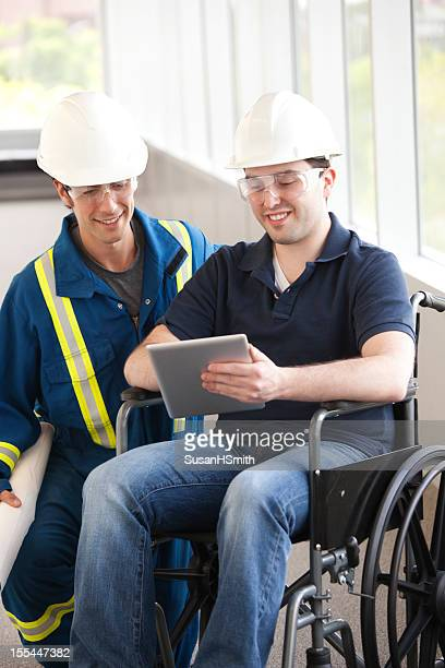 Industrial Workers With A Wheelchair and Tablet
