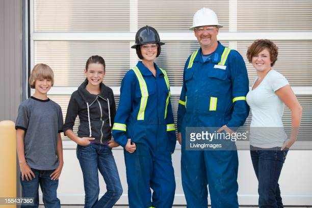 Industrial workers with their kids
