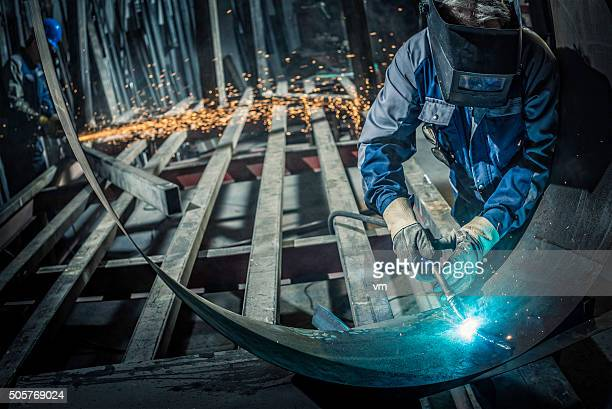 Industrial workers with welding tool