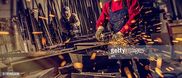 Industrial workers with work tools