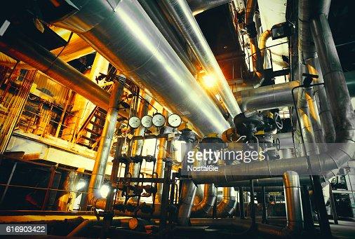 Industrial zone, Steel pipelines in blue tones : Stock Photo