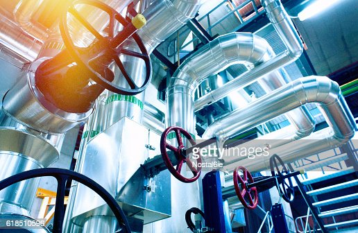 Industrial zone, Steel pipelines, valves and cables : Stock Photo