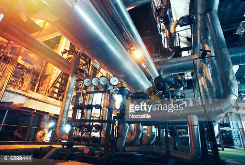 Industrial zone, Steel pipelines, valves and gauges : Stock Photo