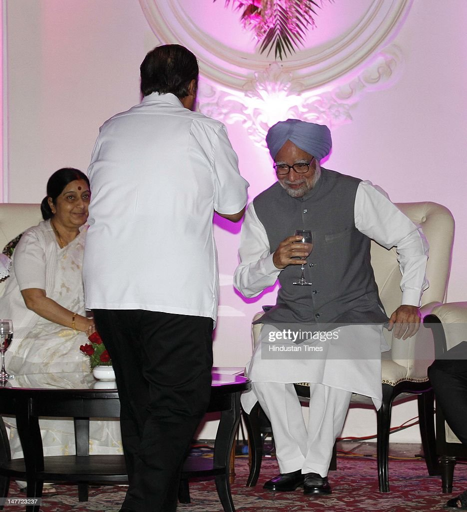 Industrialist Mukesh Ambani greets Prime Minister Manmohan Singh as BJP leader Shushma Swaraj looks on during wedding reception of BJP president Nitin Gadkar's son Sarang Gadkari's on July 2, 2012 in New Delhi, India. Nitin Gadakari's younger son Sarang tied knot with his classmate Madhura on June 24, 2012 in Nagpur.