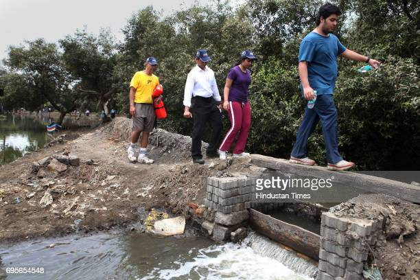 Industrialist Mukesh Ambani is daughter Isha son Akash Ambani visit the mangroves within the Mithi River as a part of a visit by a citybased think...