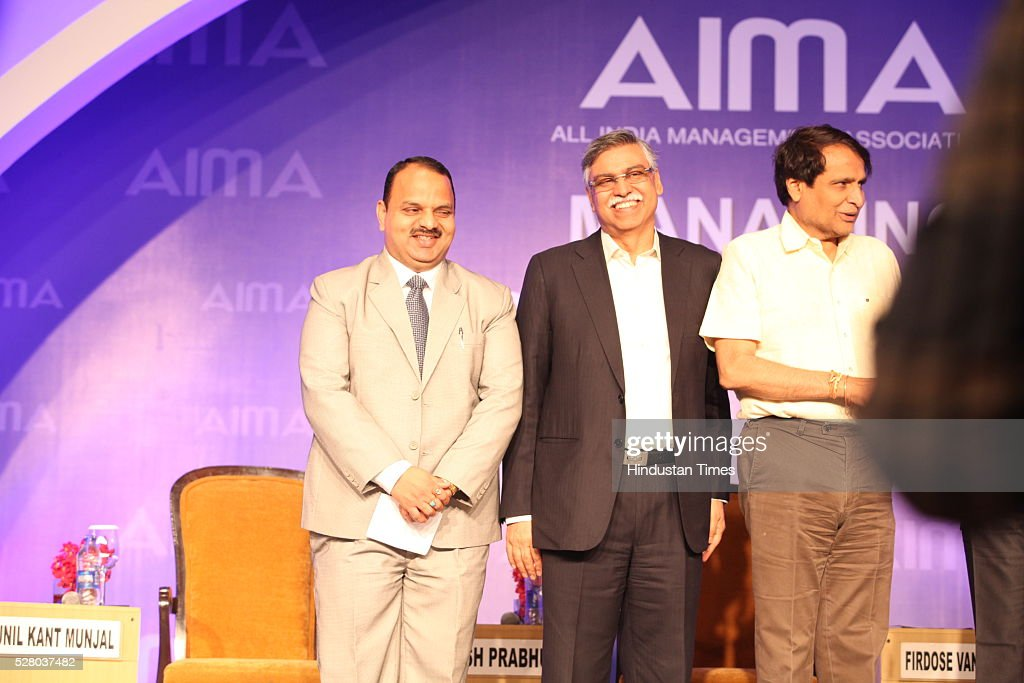 Industrialist Sunil Kant Munjal (C), and Union Railway Minister Suresh Prabhu (R) during the All India Management Association (AIMA)s Managing India Awards 2016 at Hotel Taj Palace in New Delhi, India.
