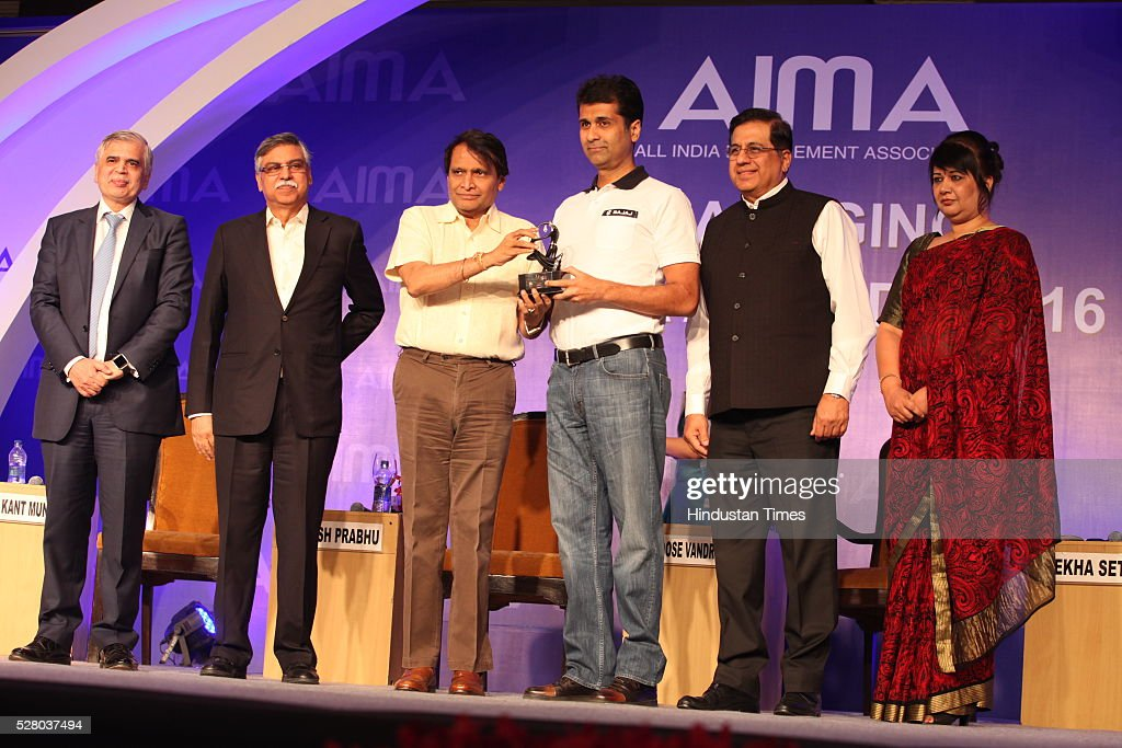 Industrialist Sunil Kant Munjal (2L), Union Railway Minister Suresh Prabhu, Firdose Vandrevala (2R) with Rekha Sethi (R) during the All India Management Association (AIMA)s Managing India Awards 2016 at Hotel Taj Palace in New Delhi, India.