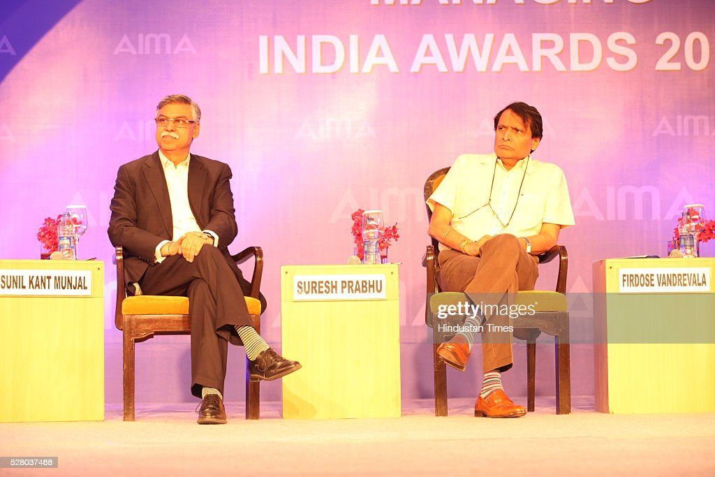 Industrialist Sunil Kant Munjal with Union Railway Minister Suresh Prabhu during the All India Management Association (AIMA)s Managing India Awards 2016 at Hotel Taj Palace in New Delhi, India.