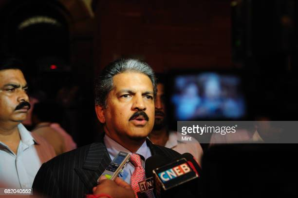 Industrialists Anand Mahindra speaks to media after a meeting with Union Finance Minister Pranab Mukherjee