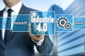 Industrie 4.0 in german industry touchscreen is operated by businessman background
