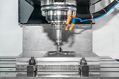 Industry machine precision part by CNC machine centre working in factory.