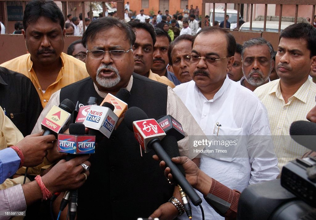 Industry Minister Partha Chatterjee (L) alongwith Mayor Sovon Chattopadhay addressing the media in front of Katapur Police Morgue after the firing incident during a political clash at Harimohan Ghosh College, in Garden Reach on February 12, 2013 in Kolkata, India. Tapas Chowdhury, a sub-inspector attached to the city police's Special Branch, was shot at from close range while trying to control the clashing student activists of the Trinamool Congress and the Congress in Harimohan Ghose College in the Garden Reach area of west Kolkata.