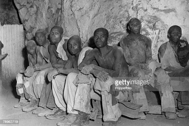 April 1947 A group of miners take a break in a diamond mine