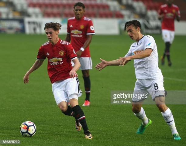 Indy Boonen of Manchester United U23s in action with Jack Evans of Swansea City during the Premier League 2 match between Manchester United U23s and...