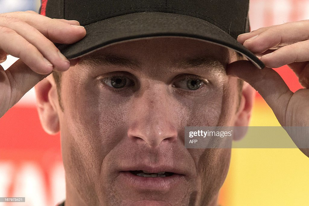 U.S. IndyCar driver Ryan Hunter-Reay adjusts his cap during a press conference in Sao Paulo, Brazil on May 3, 2013. The Itaipava Indy 300 Nestle race will take place May 4 and 5. AFP PHOTO/Yasuyoshi CHIBA