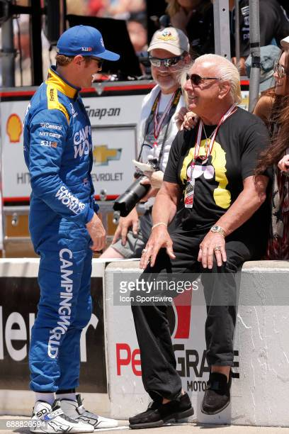 Indycar driver Scott Dixon of Chip Ganassi Racing talks with retired pro wrestler Rick Flair during Carb Day on May 26 at the Indianapolis Motor...