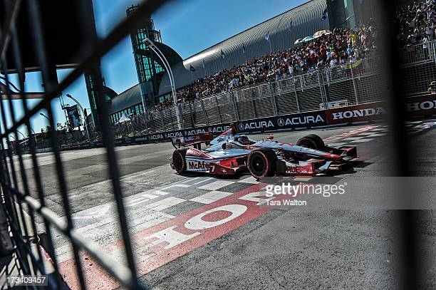 CORRECTION TORONTO ON IndyCar driver Sebastien Bourdais crosses the finish line finishing third in Saturday's race at the 2013 Honda Indy in Toronto...