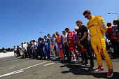 IndyCar drivers hold a moment of silence in tribute to Justin Wilson of England who passed away last Sunday at Pocono Raceway in an on track incident...