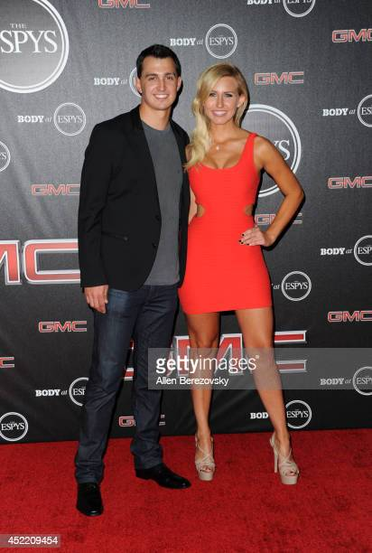 Indycar racer Graham Rahal and funny car drag racer Courtney Force attend ESPN Presents BODY At ESPYS PreParty at Lure on July 15 2014 in Hollywood...