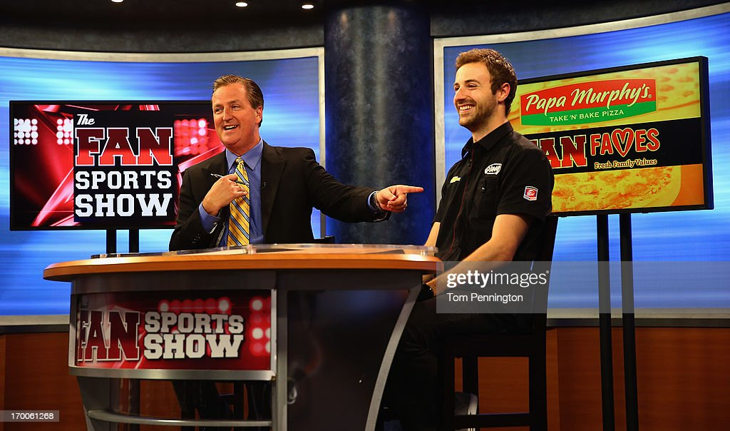IndyCar Series driver <a gi-track='captionPersonalityLinkClicked' href=/galleries/search?phrase=James+Hinchcliffe&family=editorial&specificpeople=4024510 ng-click='$event.stopPropagation()'>James Hinchcliffe</a> co-hosts The Fan Sports Show with anchor Bill Jones at the TXA television studio on June 6, 2013 in Fort Worth, Texas.