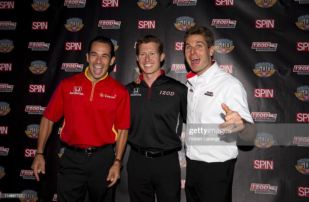 IndyCar Series drivers Helio Castroneves, Ryan Briscoe and Will Power pose for a photo before the IZOD and Spin Magazine 100th Anniversary Indianapolis 500 Welcome Party during the weekend of the 95th running of the Indianapolis 500 on May 27, 2011 at the NK Hurst Bean Company in Indianapolis, Indiana.