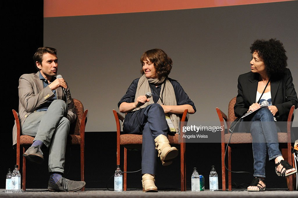'Inequality For All' producer Sebastian Dungan (L) speaks as 'Afternoon Delight' writer/director <a gi-track='captionPersonalityLinkClicked' href=/galleries/search?phrase=Jill+Soloway&family=editorial&specificpeople=1131373 ng-click='$event.stopPropagation()'>Jill Soloway</a> (C)and 'Peeples' and 'Hustle and Flow' producer and Los Angeles Film Festival director <a gi-track='captionPersonalityLinkClicked' href=/galleries/search?phrase=Stephanie+Allain&family=editorial&specificpeople=2079610 ng-click='$event.stopPropagation()'>Stephanie Allain</a> (R) listen onstage at the Film Independent Forum at the DGA Theater on October 26, 2013 in Los Angeles, California.