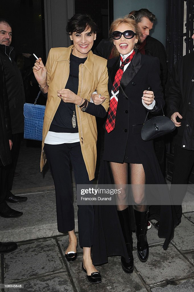 <a gi-track='captionPersonalityLinkClicked' href=/galleries/search?phrase=Ines+de+la+Fressange&family=editorial&specificpeople=2078500 ng-click='$event.stopPropagation()'>Ines de la Fressange</a> (L) and <a gi-track='captionPersonalityLinkClicked' href=/galleries/search?phrase=Arielle+Dombasle&family=editorial&specificpeople=616903 ng-click='$event.stopPropagation()'>Arielle Dombasle</a> arrive at the Jean-Paul Gaultier show as part of the Paris Haute Couture Fashion Week Spring/Summer 2011 at Atelier Jean-Paul Gaultier on January 26, 2011 in Paris, France.