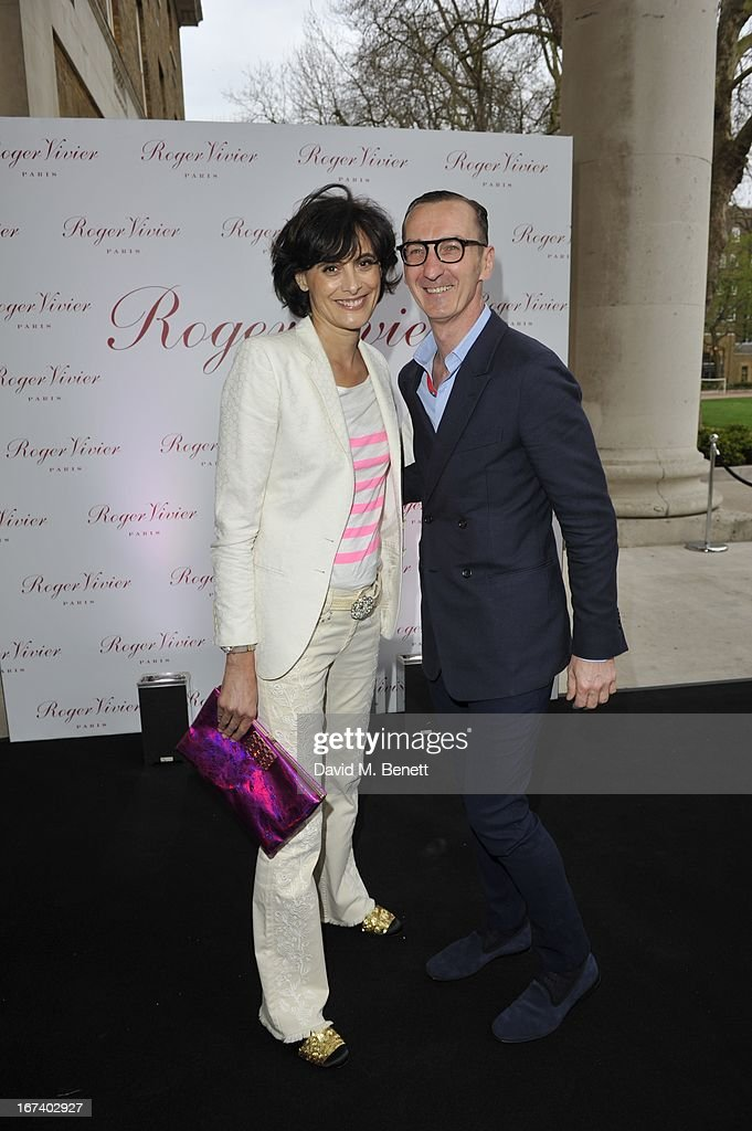 Ines de la Fressange and Bruno Frisoni arrive at the Roger Vivier Book published by Rizzoli UK launch party at Saatchi Gallery on April 24, 2013 in London, England.