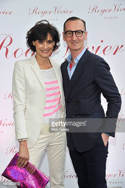 Ines de la Fressange and Bruno Frisoni attend the Roger Vivier book launch party at Saatchi Gallery on April 24 2013 in London England
