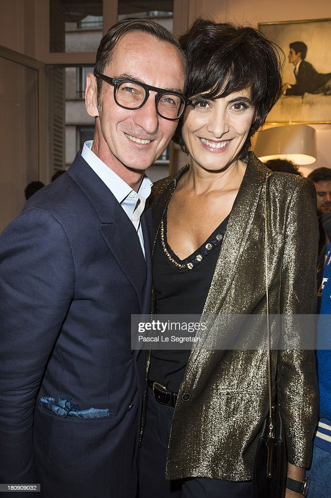 Ines de La Fressange (R) and Bruno Frisoni attend the Vogue Fashion Night Out event at boutique Roger Vivier on 29 Faubourg Saint-Honore, on September 17, 2013 in Paris, France.