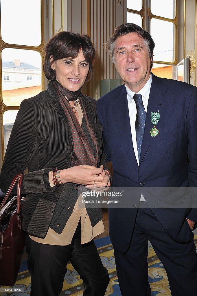 Ines De La Fressange (L) and Bryan Ferry (R) pose at Ministere de la Culture on April 4, 2012 in Paris, France.