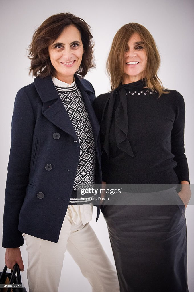 Ines de la Fressange and Carine Roitfeld attend the Carine Roitfeld Collection For Uniqlo Presentation as part of the Paris Fashion Week Womenswear...