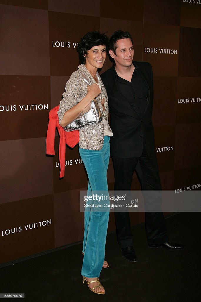 Ines de la Fressange and date arrive at the opening of the new and biggest Louis Vuitton shop in the world on the Champs Elysees, Paris.