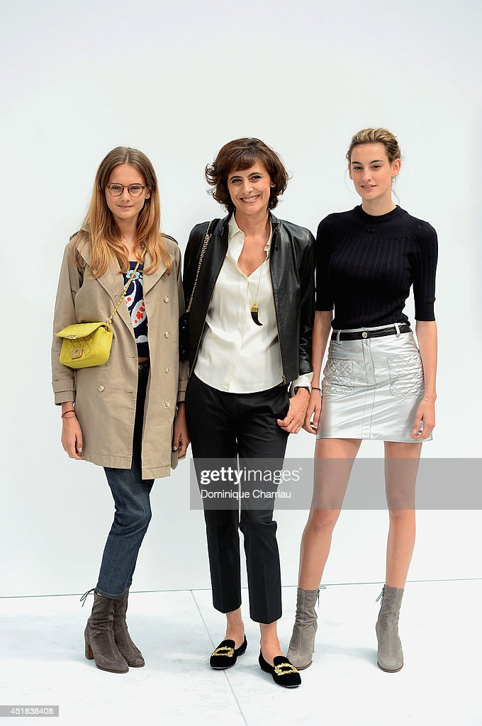 Ines De La Fressange (C) and her daughters Violette d'Urso (L) and Nine d'Urso (R) attend at Chanel show as part of Paris Fashion Week - Haute Couture Fall/Winter 2014-2015 at Grand Palais on July 8, 2014 in Paris, France.