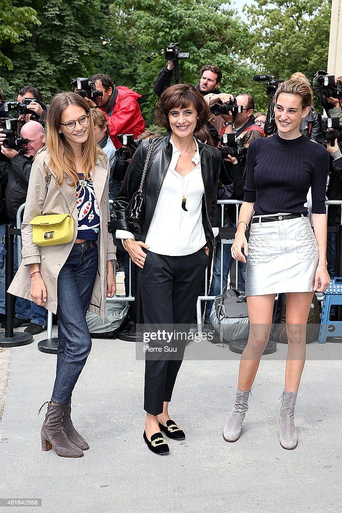 Ines De La Fressange (C) and her daughters Violette d'Urso (L) and Nine d'Urso (R) attend the Chanel show as part of Paris Fashion Week - Haute Couture Fall/Winter 2014-2015 at Grand Palais on July 8, 2014 in Paris, France.