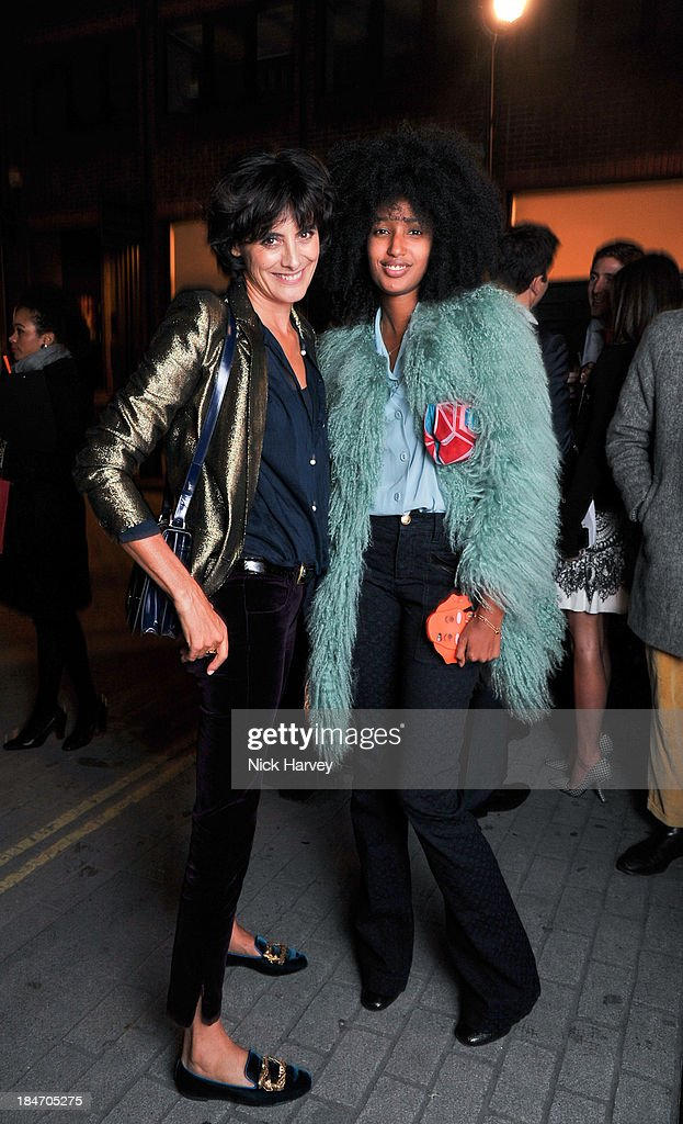 Ines De La Fressange and <a gi-track='captionPersonalityLinkClicked' href=/galleries/search?phrase=Julia+Sarr-Jamois&family=editorial&specificpeople=6243924 ng-click='$event.stopPropagation()'>Julia Sarr-Jamois</a> attend the Roger Vivier Virgule party at Le Baron on October 15, 2013 in London, England.