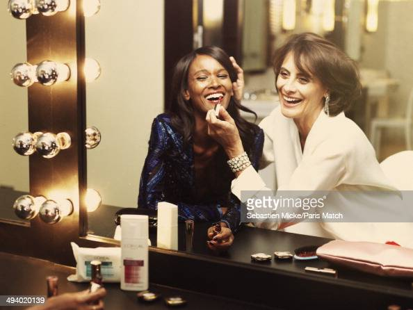 Ines de la Fressange and Liya Kebede both muses of l'Oreal pose at the Hotel Martinez during the 67th Cannes film festival on May 15 2014 in...