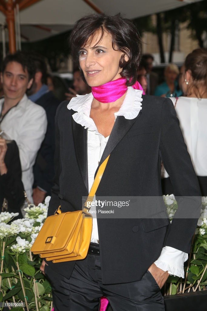 <a gi-track='captionPersonalityLinkClicked' href=/galleries/search?phrase=Ines+de+la+Fressange&family=editorial&specificpeople=2078500 ng-click='$event.stopPropagation()'>Ines de la Fressange</a> arrives to attend the 'The Glory of Water' Karl Lagerfeld's exhibition at FENDI store on Avenue Montaigne on July 3, 2013 in Paris, France.