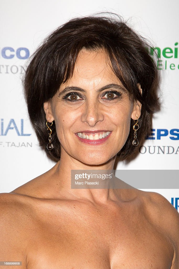 Ines de la Fressange attends the 'Planet Finance' dinner photocall at the 'Carlton' hotel during the 66th annual Cannes Film Festival on May 16, 2013 in Cannes, France.