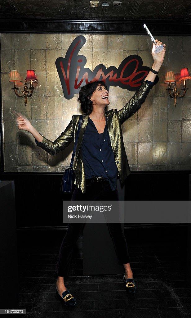 Ines De La Fressange attends the Roger Vivier Virgule party at Le Baron on October 15, 2013 in London, England.