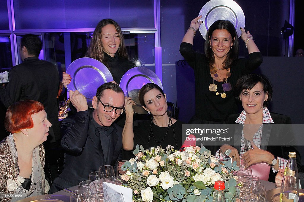 Ines de la Fressange (R), Bruno Frisoni (2nd L) and guests attend the Sidaction Gala Dinner 2013 at Pavillon d'Armenonville on January 24, 2013 in Paris, France.