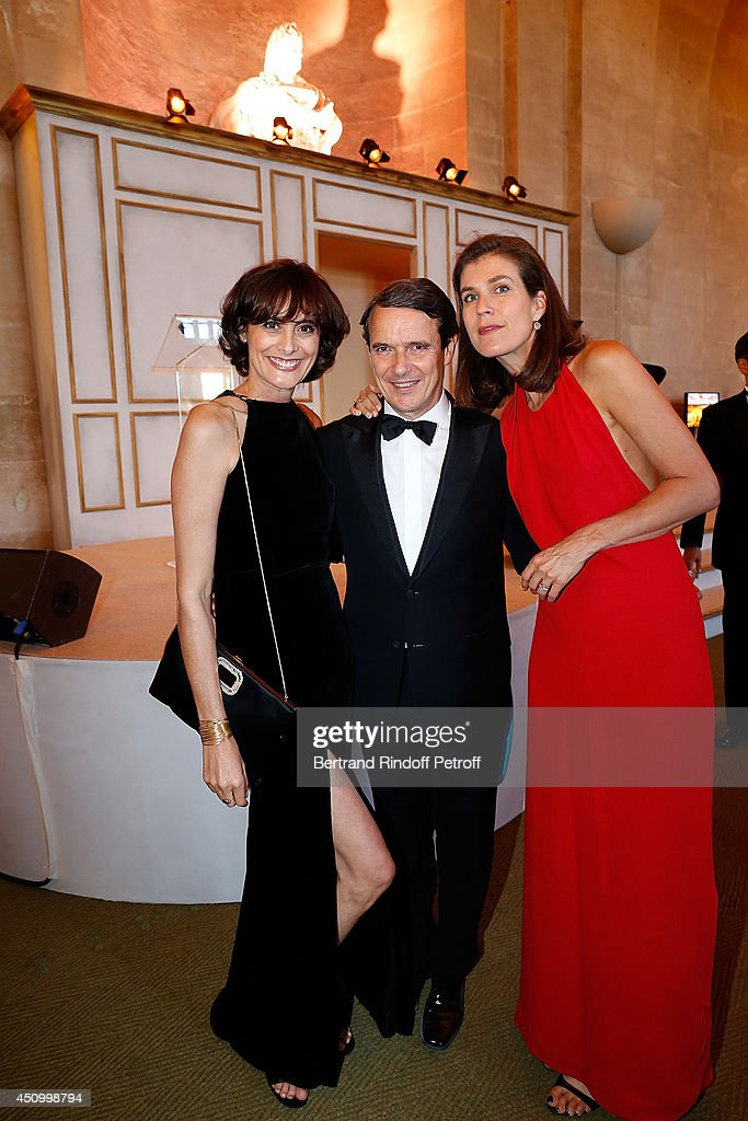 Ines de la fressange, Marc Menesguen and his wife Vanessa attend the L'Oreal Gala Evening 2014 at Chateau de Versailles on June 20, 2014 in Versailles, France.