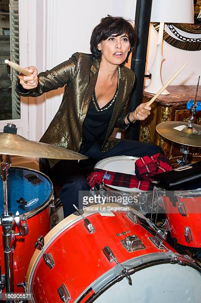 Ines de la Fressange plays drums during the Vogue Fashion Night Out at boutique Roger Vivier on Faubourg SaintHonore on September 17 2013 in Paris...