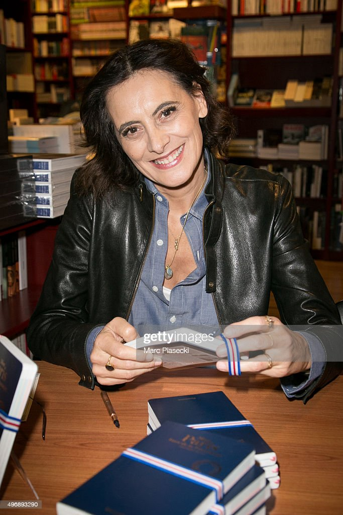 Ines de la Fressange signs copies of her book 'Mon Paris' at 'L'Ecume des Pages' bookshop on November 12, 2015 in Paris, France.