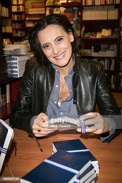 Ines de la Fressange signs copies of her book 'Mon Paris' at 'L'Ecume des Pages' bookshop on November 12 2015 in Paris France