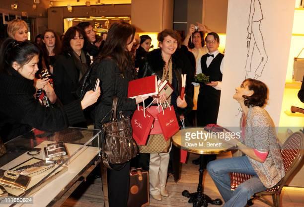 Ines de la Fressange signs copies of her new book 'Parisian Chic A Style Guide by Ines de la Fressange' at the Roger Vivier Boutique on April 5 2011...