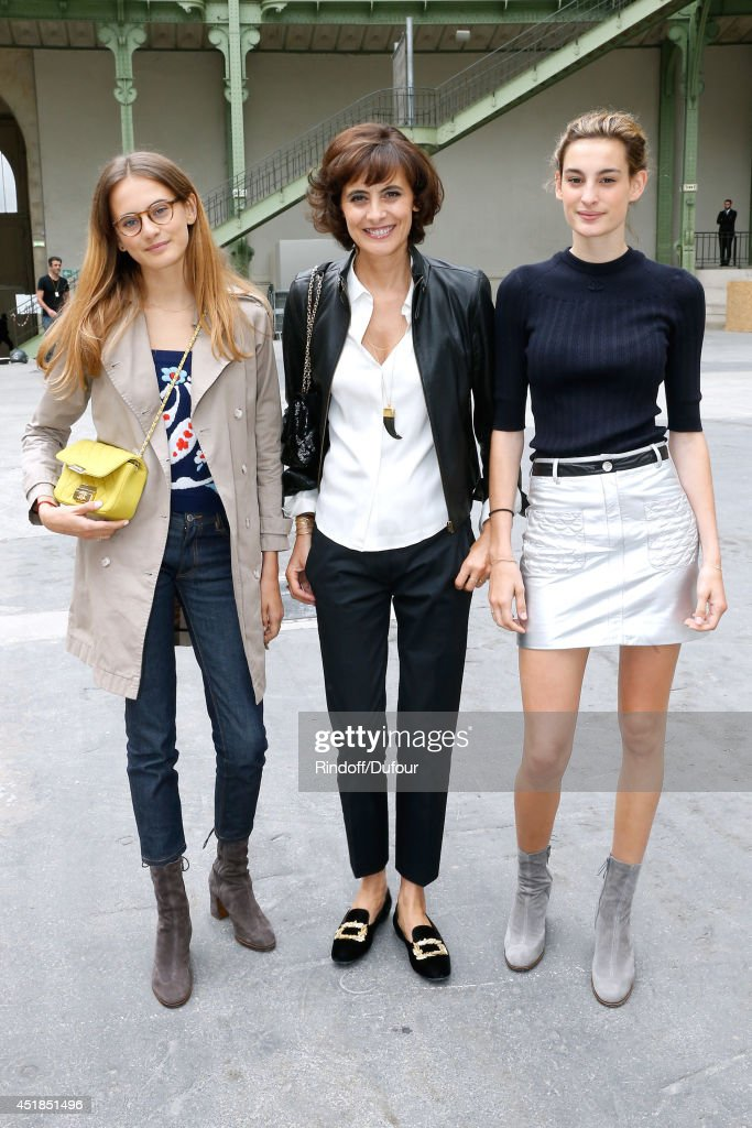 Ines de la Fressange standing between her daughters Nine and Violette d'Urso attend the Chanel show as part of Paris Fashion Week - Haute Couture Fall/Winter 2014-2015. Held at Grand Palais on July 8, 2014 in Paris, France.